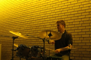 Thomas Pribyl of the Mac Walsh Trio plays the drums.